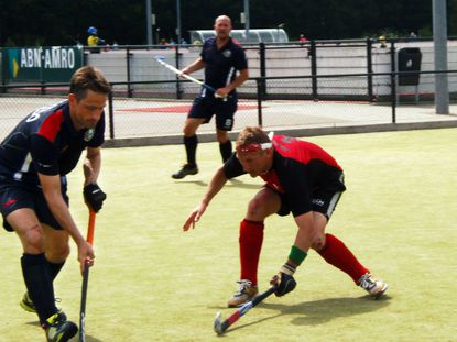 Alvaro Salcedo, left, a Roland Park resident and Gilman upper school teacher, played in the Masters Hockey World Cup in the Netherlands.