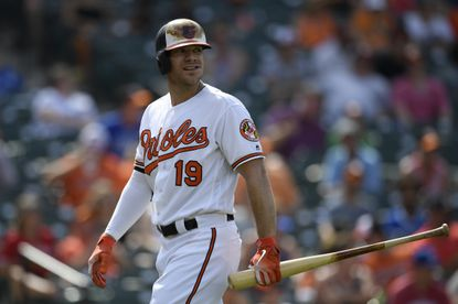 Chris Davis is restrained in Orioles-Yankees dugout blowup