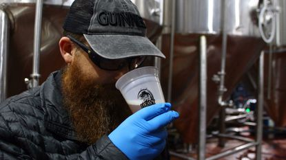 Guinness Open Gate Brewery & Barrel House brewmaster Peter Wiens samples a beer at Heavy Seas Beer in nearby Halethorpe. On Friday, the two companies will release their first collaboration.