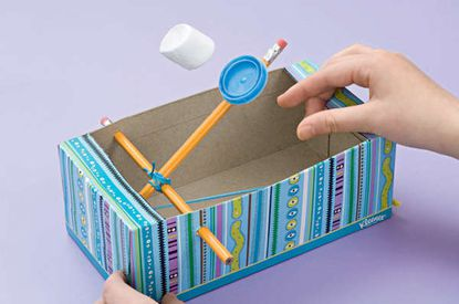 Make your own marshmallow catapult with a couple of pencils, a tissue paper box and two rubber bands -then, let 'em rip!