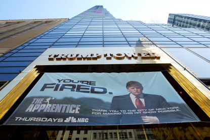 """An advertisement for """"The Apprentice"""" hangs on Trump Tower on Fifth Avenue in New York, March 23, 2004. Tax records show that """"The Apprentice"""" rescued Donald Trump, bringing him new sources of cash and a myth that would propel him to the White House."""