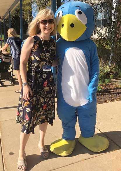 Jane Martin, principal at Pot Spring Elementary, with the school mascot, BB. Martin is one of six finalists for BCPS' Principal of the Year.