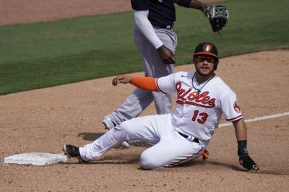 Baltimore Orioles' Yolmer Sanchez (13) safely slides into third base in the fourth inning during a spring training baseball game against the New York Yankees on Tuesday, March 2, 2021, in Sarasota, Fla. (AP Photo/Brynn Anderson)