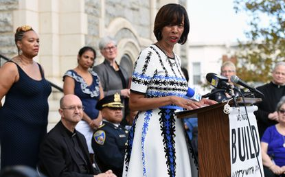 Baltimore Mayor Catherine E. Pugh talks about the parish identification card during a media conference with Archbishop William E. Lori. The card will be recognized by city agencies.