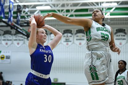 Arundel's Tye Queen (33) blocks a shot in a previous game this winter.