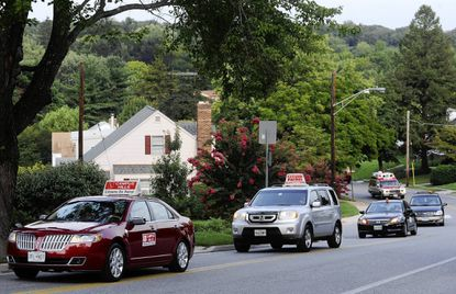 Citizens on Patrol vehicles participate in a National Night Out parade along Register Avenue in Towson.