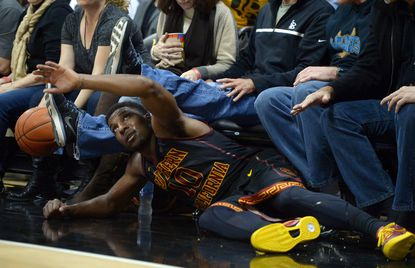 USC guard Pe'Shon Howard chases a loose ball into the crowd against Long Beach State last week.