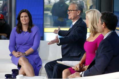 "Fox News contributor Sarah Huckabee Sanders, left, is introduced by co-host Steve Doocy, second left, for her initial appearance on the ""Fox & friends"" television program, in New York Friday, Sept. 6, 2019. Seated at right are show co-hosts Ainsley Earhardt and Brian Kilmeade. Sanders has been hired to provide political commentary and analysis across all Fox News properties, including Fox News Channel, Fox Business Network and the radio and podcast division. (AP Photo/Richard Drew)"