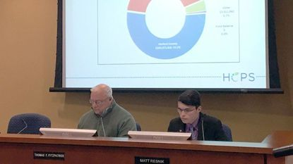 Harford County Board of Education member Thomas Fitzpatrick, left, and student representative Matt Resnik listen during a work session Wednesday on the school system's fiscal 2019 budget.