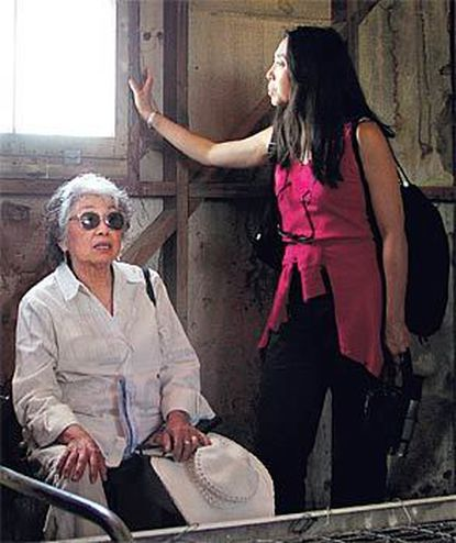 Mitsuye and Jeni Yamada visualize how it was during the long, desolate months of internment at the Minidoka camp as they tour a reconstructed barracks at the nearby Idaho Farm and Ranch Museum.