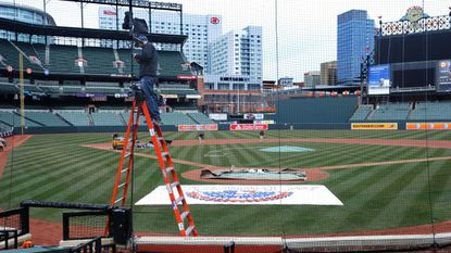 Matt Schliftman with MASN sets up a camera at Oriole Park at Camden Yards as part of the preparation for Opening Day in this 2014 file photo.