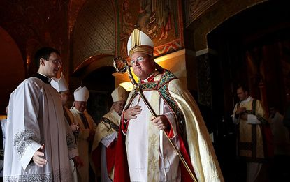 ADVANCE FOR FEB. 15 - In this photo taken on Saturday, Jan. 26, 2013, CCardinal Timothy Dolan, archbishop of New York, takes part in the recessional for Stan Musial during his funeral at the Cathedral Basilica in St. Louis. Prevailing modern wisdom has been that an American - or a citizen of any superpower - could not be elected pope. Many Vatican watchers still think that's true, but others say that Dolan, a Ballwin native, may represent the first real prospect of an American pontificate. (AP Photo/St. Louis Post-Dispatch, Robert Cohen) EDWARDSVILLE INTELLIGENCER OUT; THE ALTON TELEGRAPH OUT