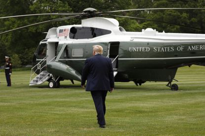 President Donald Trump walks to board the Marine One helicopter on the South Lawn of the White House on May 21, 2020.