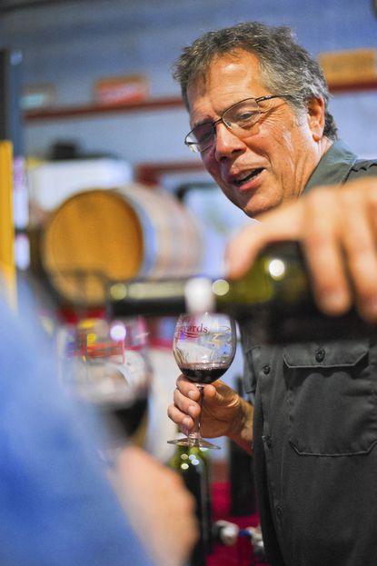 Dave Zuchero pours wine during a wine tasting at Tin Lizzie Thursday, Aug 21, 2014