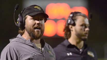 Century football coach Todd Edmondson looks on during the second half against Westminster on Oct. 5, 2018.