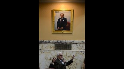 Maryland Senate President Emeritus Thomas V. Mike Miller looks up at supporters as he is applauded by his colleagues, after his portrait was unveiled in the Senate chamber in the State House in Annapolis on Monday, Jan. 13, 2020. He passed away one year later after a long bout with cancer. (Pamela Wood/Baltimore Sun)