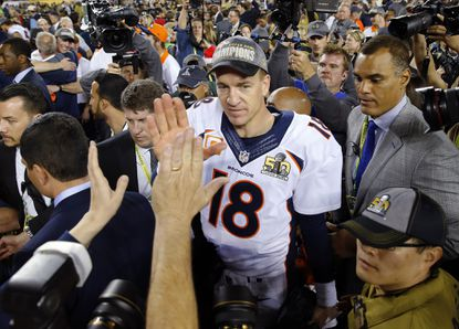 Broncos quarterback Peyton Manning and Ravens spokesman Chad Steele, right.