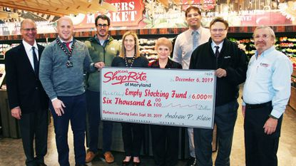 Members of the Klein family present their donation to representatives of the Empty Stocking Fund. The family and their ShopRite supermarkets are major community givers in Harford County. The Empty Stocking Fund was started by employees of The Aegis more than 25 years ago.