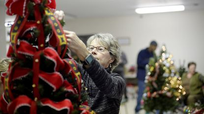 Kristy Vandervalk of Westminster decorates one of the trees that will be featured in the annual Shepherd's Staff Festival of Trees which will be held November 23rd - 26th, 2017 at John Street Quarters in Westminster