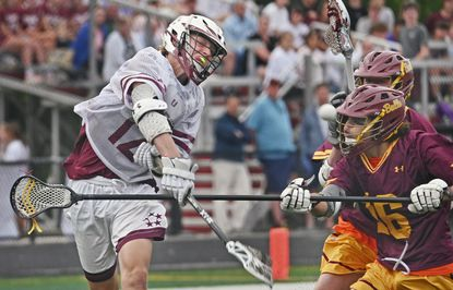 Towson's Nate Hochrein, left, shoots past Hereford's Jacob Harris, right, to score in the first quarter of boys lacrosse game on June 1, 2021.