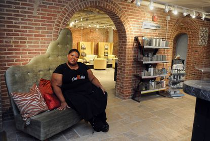 Baltimore, MD -- This is Rosalind Holsey, owner of Studio 7 The Salon, who is expanding her salon into a spa on the lower level of 800 N. Charles Street. She is pictured in the new spa's waiting area.