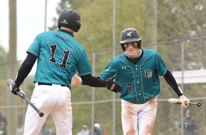 Patterson Mill's Aiden Laurentius (7) celebrates scoring the game-tying run in the 6th inning with teammate Caleb Heymann during a baseball game against North Harford at Patterson Mill High School on Friday, April 23, 2021.