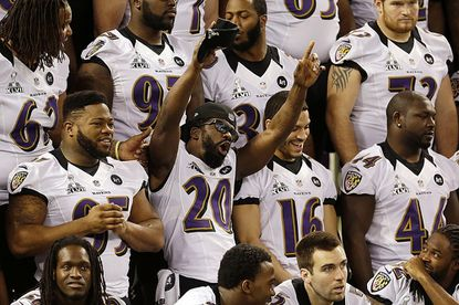 Ravens safety Ed Reed (20) reacts during the team photo session at Super Bowl media day Jan. 29, 2013 in New Orleans.