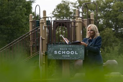 Jill Biden, wife of Democratic presidential candidate former Vice President Joe Biden, walks from a podium in front of a closed playground during a tour of the Evan G. Shortlidge Academy in Wilmington, Del., Tuesday, Sept. 1, 2020, to launch a multi-week swing through 10 battleground states. (AP Photo/Carolyn Kaster)