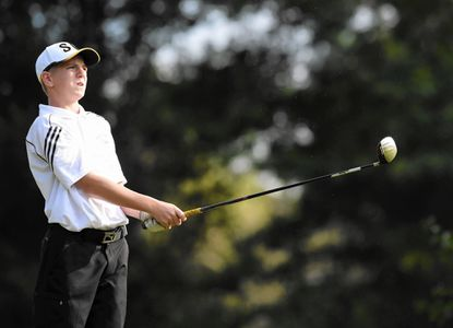 South Carroll's C.J. Smith watches his tee shot on the sixth hole at the Links at Challedon during a match Monday, Sept. 15, 2014.