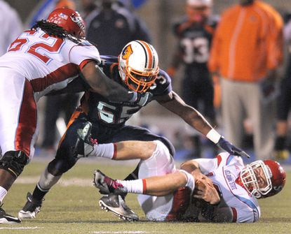Morgan State linebacker Christopher Johnson converges on a Delaware State player.