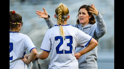 Annapolis Panthers Head Coach Stephy Samaras talks with team during timeout against the Southern Bulldogs at Annapolis High School.