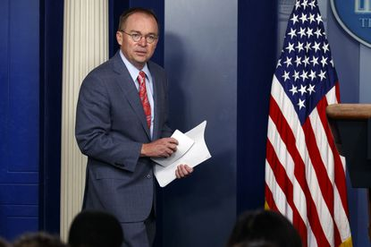 During a news conference, White House acting chief of staff Mick Mulvaney defended President Trump's decision, later reversed, to hold an international meeting at his own golf club.