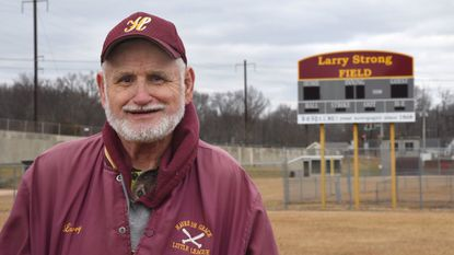 Larry Strong, a volunteer with the Havre de Grace Little League for 35 years, stands on the baseball field that bears his name.