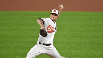 Pticher Tanner Scott made his major league debut for the Orioles against the Red Sox at Camden Yards.
