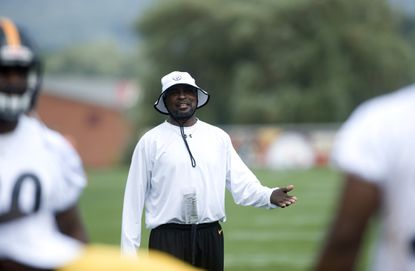 Pittsburgh Steelers running back coach Kirby Wilson looks on during the team's 2012 training camp.