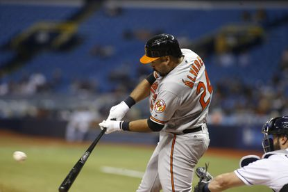 Pedro Alvarez #24 of the Baltimore Orioles hits a double in front of catcher Curt Casali #19 of the Tampa Bay Rays during the third inning of a game on April 25, 2016 at Tropicana Field in St. Petersburg, Florida.  **