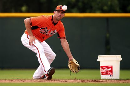 Orioles shortstop J.J. Hardy fields ground balls during a spring training workout in Sarasota, Fla.