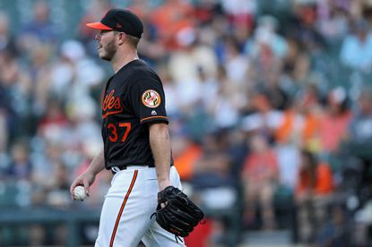 Starting pitcher Dylan Bundy of the Baltimore Orioles looks on after allowing a run to Travis d'Arnaud of the Tampa Bay Rays (not pictured) during the first inning at Oriole Park at Camden Yards on July 12, 2019 in Baltimore.