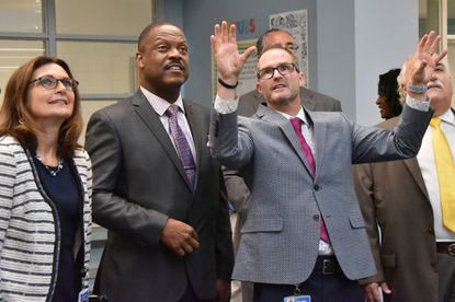 From left, Kathleen Causey, chair of the Baltimore County Board of Education, Darryl Williams, the system's superintendent, and Mike Parker, Dundalk Elementary School principal, on the first day of school last year.
