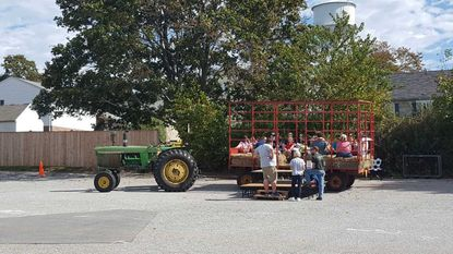 Community members enjoy the Hampstead Fall Fest in 2017 and partake in a hayride. This year's event will be held Saturday, Oct. 6, and organizers are seeking vendors.