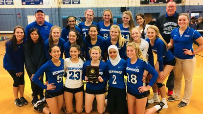 Sherwood's volleyball team poses with the 4A North region championship plaque after its 3-2 win over Howard on Nov. 10.