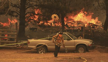 The Ranch Fire spots out ahead of the main fire in Spring Valley, burning two homes on Aug. 6, 2018, during the battle to stop the spread of the massive fire in California's Lake County.