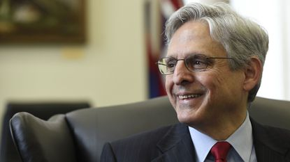 In this May 10, 2016 file photo, Supreme Court nominee Merrick Garland meets with Sen. Brian Schatz, D-Hawaii, on Capitol Hill in Washington.