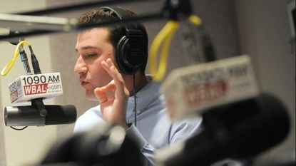 "Brett Hollander talks over the air in the WBAL radio studio during a broadcast of ""Sportsline with Brett Hollander"" on Feb. 22, 2011."