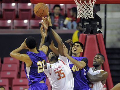 Damonte Dodd (35) and Jon Graham battle for a loose ball against San Francisco State in the Terps' first exhibition game.