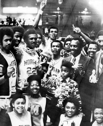 The Morgan State College Bears, coaching staff and cheerleaders pose for the victory awards after downing Southwest Missouri State in the final game of the NCAA College Division National Basketball Championship.