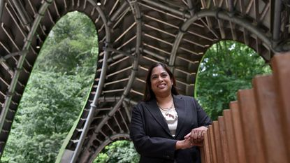 Nina Basu is president and CEO of Inner Arbor Trust Inc. She is inside the Chrysalis on the grounds of Merriweather Post Pavilion.