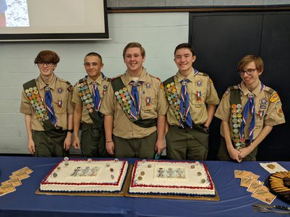 Five members of Boy Scout Troop 777 — from left, Jack Campbell, Julian Ferdick, Lucas Wheeler, Connor Seeley and Ethan Rapp — were presented with the Eagle Scout ranks during a ceremony Sunday.