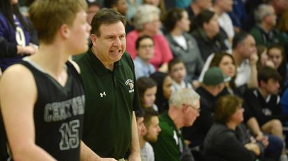 Century coach George Wunder directs players during the second half of their game against Liberty in Eldersburg Monday, Feb 26, 2018.
