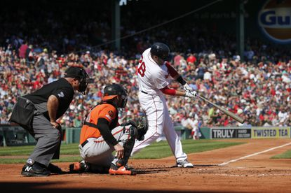 Boston Red Sox's J.D. Martinez hits a home run during the first inning of a baseball game against the Baltimore Orioles, Saturday, Sept. 28, 2019, in Boston. (AP Photo/Mary Schwalm)